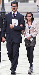 © licensed to London News Pictures. London, UK. 15/12/2012. The husband Ben Barboza (left) and The daughter Lisha (right),  of nurse Jacinta Saldanha arrive at Westminster Cathedral in London to attend a memorial service held for nurse Jacinta Saldanha who committed suicide. Photo credit: Tolga Akmen/LNP