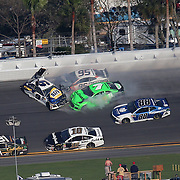 Chase Elliott, driver of the (9) NAPA Autoparts Chevrolet, Kasey Kahne, driver of the (95)Procore Chevrolet, and Danica Patrick, driver of the (7) GoDaddy Chevrolet collide as they exit turn 3 during the 60th Annual NASCAR Daytona 500 auto race at Daytona International Speedway on Sunday, February 18, 2018 in Daytona Beach, Florida. This would be Patrick's last NASCAR race.  (Alex Menendez via AP)