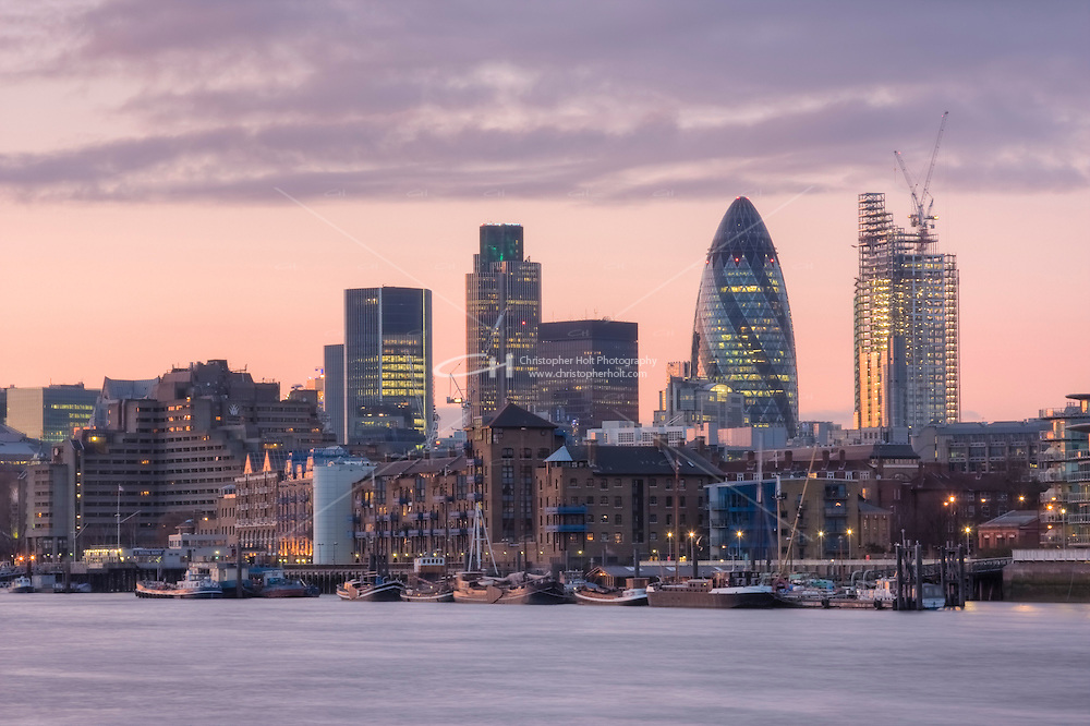 City of London and Wapping warehouses along the River Thames, at sunset