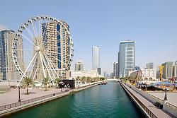 View of Eye of the Emirates ferris wheel and Al Qasba entertainment district in Sharjah United Arab Emirates