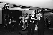 05/04/1965<br /> 04/05/1965<br /> 05 April 1965<br /> Second Irish Export Fashion Fair opened at the Intercontinental Hotel, Dublin. Picture shows Mr J.C.B. McCarthy (left), Secretary, Department of Industry and Commerce, who opened the Fair and Mr W.H. Walsh, General Manager Coras Trachtala, examining some of the exhibitions at the fair.
