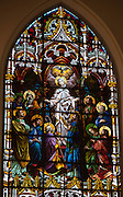 Stained glass window at St. Katharine Drexel Church in Kaukauna depicts the descent of the Holy Spirit on Jesus' apostles and the Blessed Mother on Pentecost. (Photo by Sam Lucero)