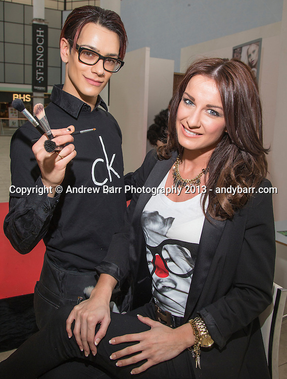 15:03:2013 ..Miss Scotland Fashion Event in St. Enoch centre...Former finalist Deonne Roberston shows off make-up job with artist Ross Townsend of CK One..   . Pic:Andy Barr..07974 923919  (mobile).andy_snap@mac.com..All pictures copyright Andrew Barr Photography. ..Please contact before any syndication. .