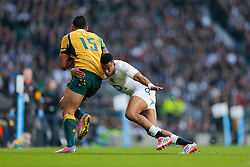 Australia Full Back Israel Folau is tackled by England Winger Anthony Watson - Photo mandatory by-line: Rogan Thomson/JMP - 07966 386802 - 29/11/2014 - SPORT - RUGBY UNION - London, England - Twickenham Stadium - England v Australia - QBE Autumn Internationals.