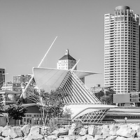 Milwaukee skyline panorama photo in black and white. Panoramic picture ratio is 1:3 and includes University Club Tower, Northwestern Mutual Tower, and Milwaukee Art Museum.