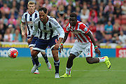 West Bromwich Albion defender Joleon Lescott defends the ball from Stoke City forward Mame Diouf during the Barclays Premier League match between Stoke City and West Bromwich Albion at the Britannia Stadium, Stoke-on-Trent, England on 29 August 2015. Photo by Aaron Lupton.