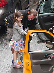 "Day two of filming. The youngest of Brad Pitt's co-star helps to wet their car on the set of the movie ""World War Z"" being shot in the city centre of Glasgow. The film, which is set in Philadelphia, is being shot in various parts of Glasgow, transforming it to shoot the post apocalyptic zombie film.."