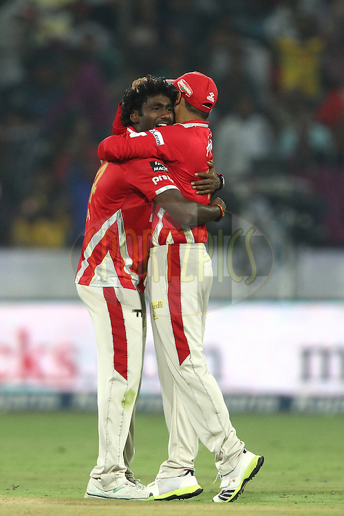 Parvinder Awana of the Kings XI Punjab is congratulated by Virender Sehwag of the Kings XI Punjab for getting Chennai Super Kings captain MS Dhoni wicket during the second semi final match of the Oppo Champions League Twenty20 between the Kings XI Punjab and the Chennai Superkings held at the Rajiv Gandhi Cricket Stadium, Hyderabad, India on the 2nd October 2014<br /> <br /> Photo by:  Shaun Roy / Sportzpics/ CLT20<br /> <br /> <br /> Image use is subject to the terms and conditions as laid out by the BCCI/ CLT20.  The terms and conditions can be downloaded here:<br /> <br /> http://sportzpics.photoshelter.com/gallery/CLT20-Image-Terms-and-Conditions-2014/G0000IfNJn535VPU/C0000QhhKadWcjYs