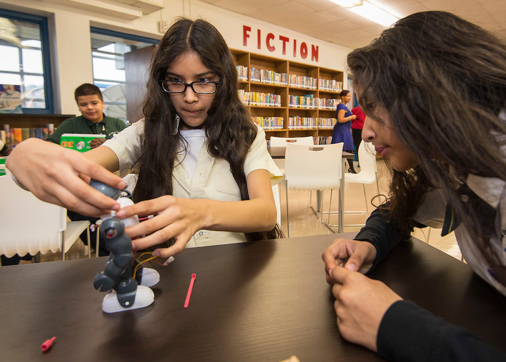 Students work on STEM projects before a library dedication at Attucks Middle School, January 18, 2017.