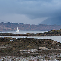 Coastal scene of Skye with yacht