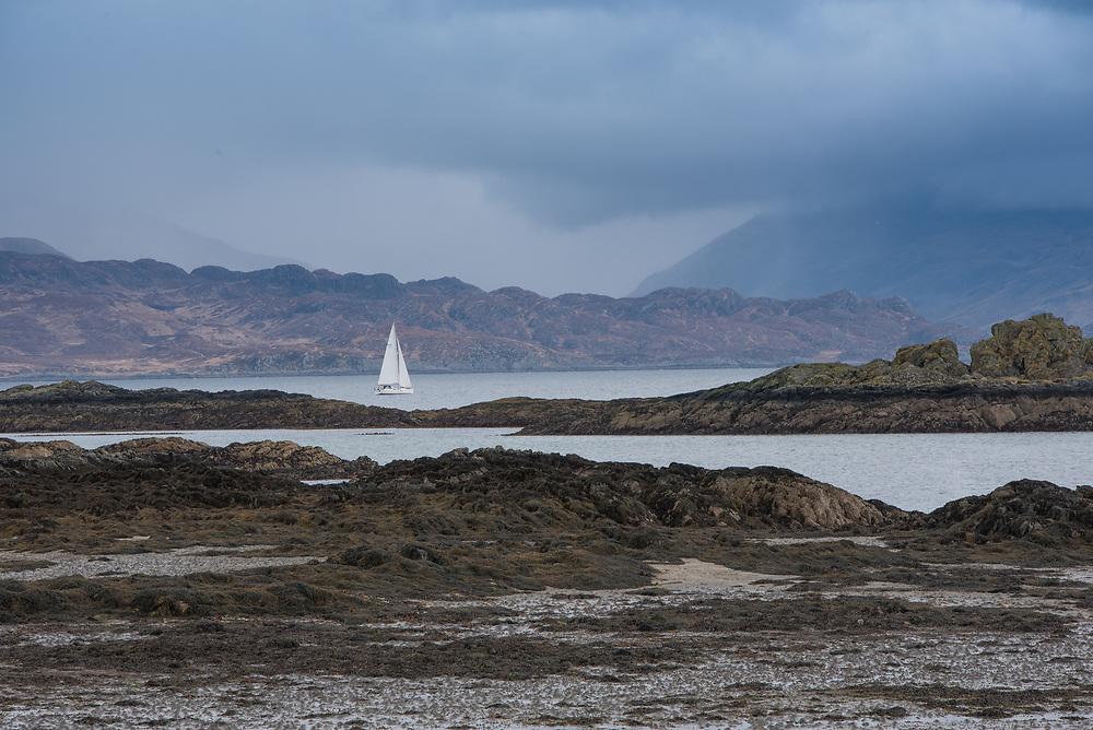 Coastal scene of Skye with yacht