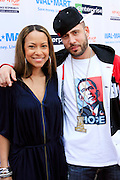 "Valiesha Butterfield, President, HipHop Action Network and DJ Drama at the Hip-Hop Summit's ""Get Your Money Right"" Financial Empowerment International Tour draws hip-hop stars and financial experts to teach young people about financial literacy held at The Johnson C. Smith University's Brayboy Gymnasium on April 26, 2008..For the past three years, hip-hop stars have come out around the country to give back to their communities. Sharing personal stories about the mistakes they've made with their own finances along the way, and emphasizing the difference between the bling fantasy of videos and the realities of life, has helped young people learn the importance of financial responsibility while they're still young. With the recent housing market crash in the United States affecting the economy, jobs, student loans and consumer confidence, young people are eager to receive sound financial advice on how to best manage their money and navigate through this volatile economic environment.."