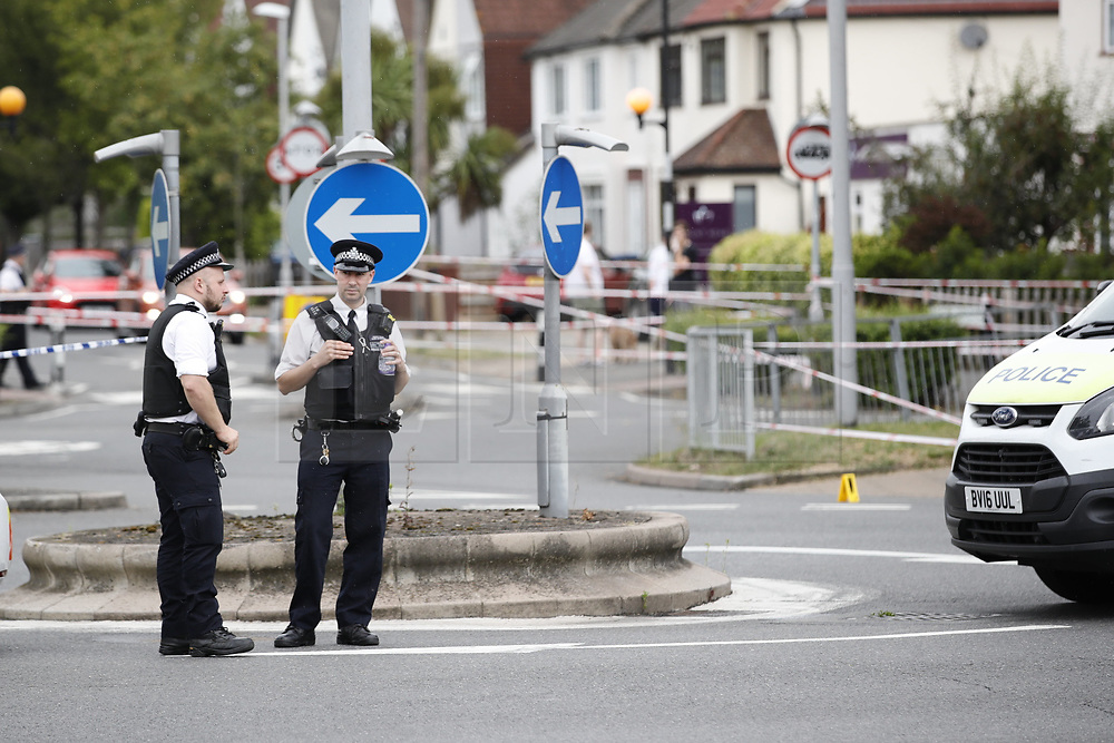 © Licensed to London News Pictures. 26/07/2019. Chessington, UK.  The scene in Moor Lane in Chessington, south west London whera a man died after being hit by a car late last night. Police were called to a car in collision with a man on Moor Lane in Chessington at 00:13hrs on Friday, 26 July. The driver did not stop and the man was dragged under the car for some distance. Emergency services arrived an the man, believed to be aged 25 years, was pronounced dead on Moor Lane. Police believe they know the man's identity and his next of kin have been informed. Formal identification and a post-mortem examination will be arranged in due course.There has been no arrest. Enquiries are underway to establish the full circumstances. Photo credit: Peter Macdiarmid/LNP