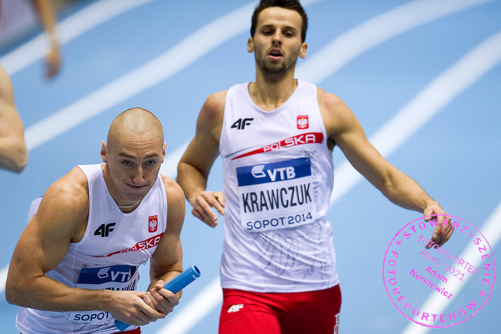(L) Jakub Krzewina and (R) Lukasz Kawczuk both of Poland compete in men's relay 4x400 meters qualification during the IAAF Athletics World Indoor Championships 2014 at Ergo Arena Hall in Sopot, Poland.<br /> <br /> Poland, Sopot, March 8, 2014.<br /> <br /> Picture also available in RAW (NEF) or TIFF format on special request.<br /> <br /> For editorial use only. Any commercial or promotional use requires permission.<br /> <br /> Mandatory credit:<br /> Photo by &copy; Adam Nurkiewicz / Mediasport
