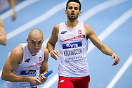 (L) Jakub Krzewina and (R) Lukasz Kawczuk both of Poland compete in men's relay 4x400 meters qualification during the IAAF Athletics World Indoor Championships 2014 at Ergo Arena Hall in Sopot, Poland.<br /> <br /> Poland, Sopot, March 8, 2014.<br /> <br /> Picture also available in RAW (NEF) or TIFF format on special request.<br /> <br /> For editorial use only. Any commercial or promotional use requires permission.<br /> <br /> Mandatory credit:<br /> Photo by © Adam Nurkiewicz / Mediasport