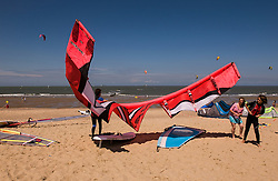 A kitesurfer readies their equipment for action. (Photo © Jock Fistick)