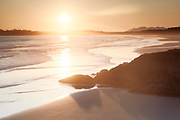 Beautiful sunset scenery of Pacific Rim National Park beach at Green Point with the soft glow of the sun. Pacific ocean shore in Tofino, Vancouver Island, BC, Canada.