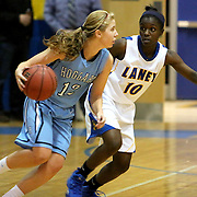 Hoggard's Julia Buehler attempts to drive on Laney's Charlene Thompson Tuesday at Laney. (Jason A. Frizzelle)