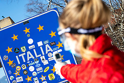Stock photo with Thermometer gun and sign for Italian border while Police officers and medics check travelers at the border crossing with Italy upon entry into Slovenia next to town Ratece, on March 12, 2020 in Ratece, Slovenia. Photo by Matic Klansek Velej / Sportida