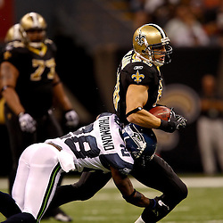 November 21, 2010; New Orleans, LA, USA; New Orleans Saints tight end Jimmy Graham (80) is hit by Seattle Seahawks cornerback Walter Thurmond (28) during the second half at the Louisiana Superdome. The Saints defeated the Seahawks 34-19. Mandatory Credit: Derick E. Hingle