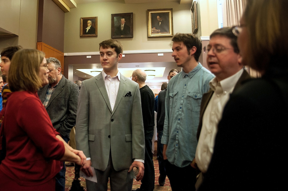 Dr. Julie Suhr (left) speaks with Alex and Michael France outside Baker University Ballroom on Tuesday, March 10 during the reception before the Distinguished Professor Portrait Unveiling and Lecture.