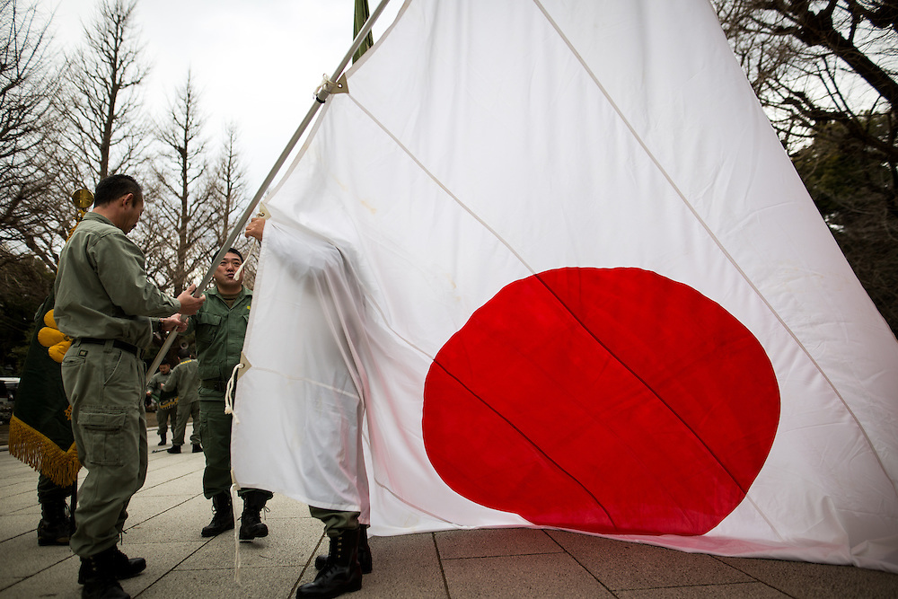 TOKYO, JAPAN - FEBRUARY 11 : Nationalist group members is seen in front of Yasukuni Shrine with a Japanese flag during a ceremony to commemorate and pay respects to the souls of those who have died in the service of Japan, marking the National Foundation Day, Saturday, Feb. 11, 2017. (Photo by Richard Atrero de Guzman/NURPhoto)