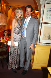MATTHEW MELLON and NOELLE RENO at a private dinner and presentation of Issa's Autumn-Winter 2005-2006 collection held at Annabel's, 44 Berkeley Square, London on 15th March 2005.<br /><br />NON EXCLUSIVE - WORLD RIGHTS