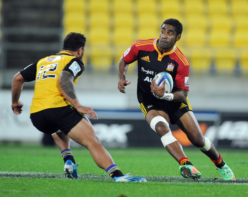 Chiefs' Aseli Tikoirotuna, right, sidesteps Hurricanes' Alapati Leiua in the Super Rugby match at Westpac Stadium, Wellington, New Zealand, Saturday, May 24, 2014. Credit:SNPA / Ross Setford