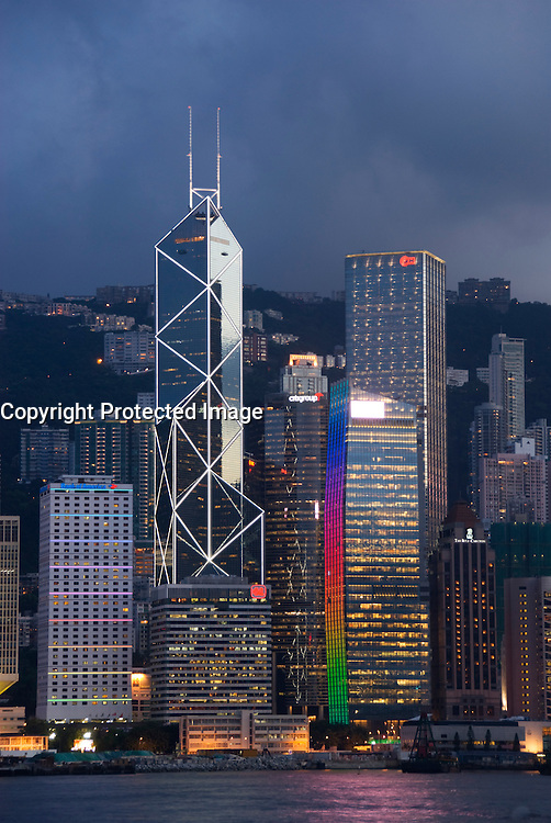 Evening view across Victoria Harbour of spectacular skyline of Central District in Hong Kong Island