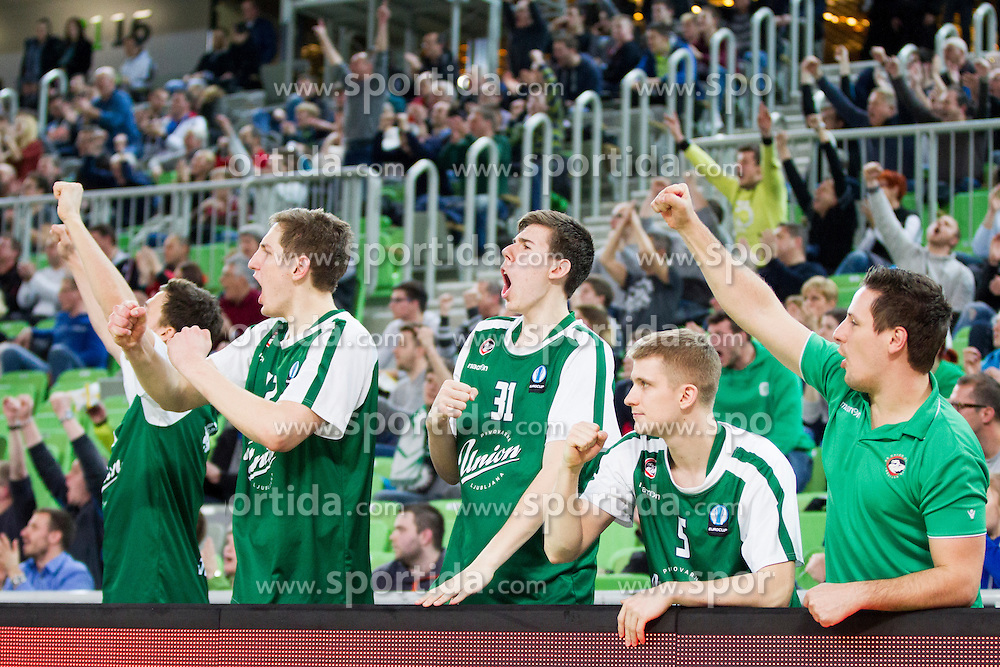 Players of KK Union Olimpija Ljubljana celebrate during basketball match between KK Union Olimpija Ljubljana and BC Maccabi Fox Tel Aviv (ISR) in 5th Round of EuroCup LAST32, on February 3rd, 2016 in Arena Stozice, Ljubljana, Slovenia. Photo by Urban Urbanc/ Sportida