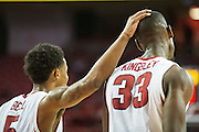 FAYETTEVILLE, AR - NOVEMBER 13:  Anthlon Bell #5 pats Moses Kingsley #33 of the Arkansas Razorbacks after he fouls out during a game against the Southern University Jaguars at Bud Walton Arena on November 13, 2015 in Fayetteville, Arkansas.  The Razorbacks defeated the Jaguars 86-68.  (Photo by Wesley Hitt/Getty Images) *** Local Caption *** Anthlon Bell; Moses Kingsley