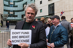 "London, November 05 2017. Several dozen protesters from the People's Charter Foundation, whose website states ""We demand for proper Brexit, and for Britain to ban Sharia law"", demonstrate outside the BBC's New Broadcasting House before marching to Parliament Square, against what they claim is left wing, pro-remain Bias by the BBC, and against the corporations's licence fee, which they state is outdated. © Paul Davey"