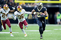 NEW ORLEANS, LA - NOVEMBER 19:  Mark Ingram II #22 of the New Orleans Saints breaks open for a long run and is chased by D.J. Swearinger #36 of the Washington Redskins at Mercedes-Benz Superdome on November 19, 2017 in New Orleans, Louisiana.  Saints defeated the Redskins 34-31.  (Photo by Wesley Hitt/Getty Images) *** Local Caption *** Mark Ingram II;  D.J. Swearinger