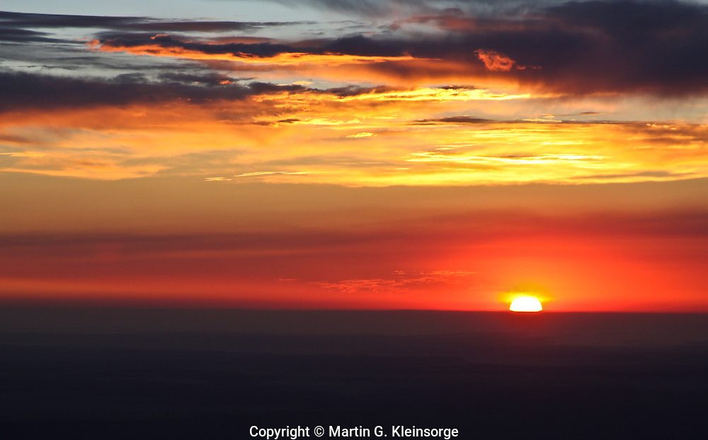 Sunrise over the Colorado plains as seen from the summit of 14,110 ft. Pikes Peak, Colorado.