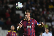 Ipswich Town defender Luke Chambers (4) heads the ball during the EFL Sky Bet League 1 match between Milton Keynes Dons and Ipswich Town at stadium:mk, Milton Keynes, England on 17 September 2019.