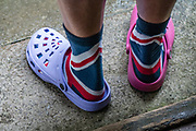 Colorful mismatched Crocs. Brownber Hall Country House in Yorkshire Dales National Park, near Kirkby Stephen, Cumbria county, England, United Kingdom, Europe. England Coast to Coast hike day 6 of 14: Ullswater to Kirkby Stephen. [This image, commissioned by Wilderness Travel, is not available to any other agency providing group travel in the UK, but may otherwise be licensable from Tom Dempsey – please inquire at PhotoSeek.com.]