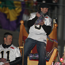 Feb 09, 2010; New Orleans, LA, USA; New Orleans Saints quarterback Drew Brees (9) and quarterback Mark Brunell (11) ride a float during the Super Bowl celebration parade for the New Orleans Saints 31-17 victory over the Indianapolis Colts in Super Bowl XLIV as the parade passed through the downtown streets of New Orleans, Louisiana.  Mandatory Credit: Derick E. Hingle-US-PRESSWIRE.