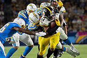 Pittsburgh Steelers running back Benny Snell (24) is being tackled by Los Angeles Chargers defensive linemen Justin Jones (93) during an NFL football game against the Los Angeles Chargers. The Steelers defeated the Chargers 24-17 on  Sunday, Oct. 13, 2019, in Carson, Calif. (Ed Ruvalcaba/Image of Sport)