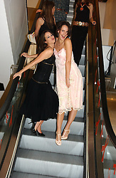Left to right, LEAH WOOD and SAFFRON ALDRIDGE at a Topshop hosted Jumbo Thrift Sale - a sale of designer fashion, in association with the Terence Higgins Trust for World Aids Day, held at Topshop, Oxford Circus, London on 1st December 2004.<br /><br />NON EXCLUSIVE - WORLD RIGHTS