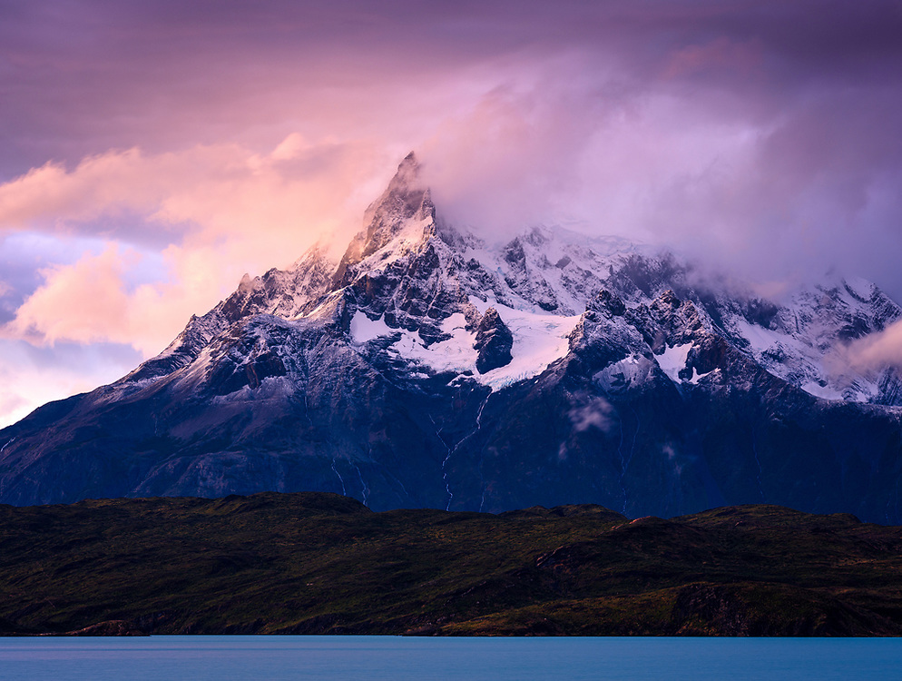 NATIONAL PARK TORRES DEL PAINE, CHILE - CIRCA FEBRUARY 2019: Sunset over the Paine Mountain Range in Torres del Paine National Park, Chile.