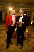 Omar Sharif and the Toastmaster, The Chain of Hope Autumn Ball, Dorchester Hotel. 8th October 2003. © Copyright Photograph by Dafydd Jones 66 Stockwell Park Rd. London SW9 0DA Tel 020 7733 0108 www.dafjones.com