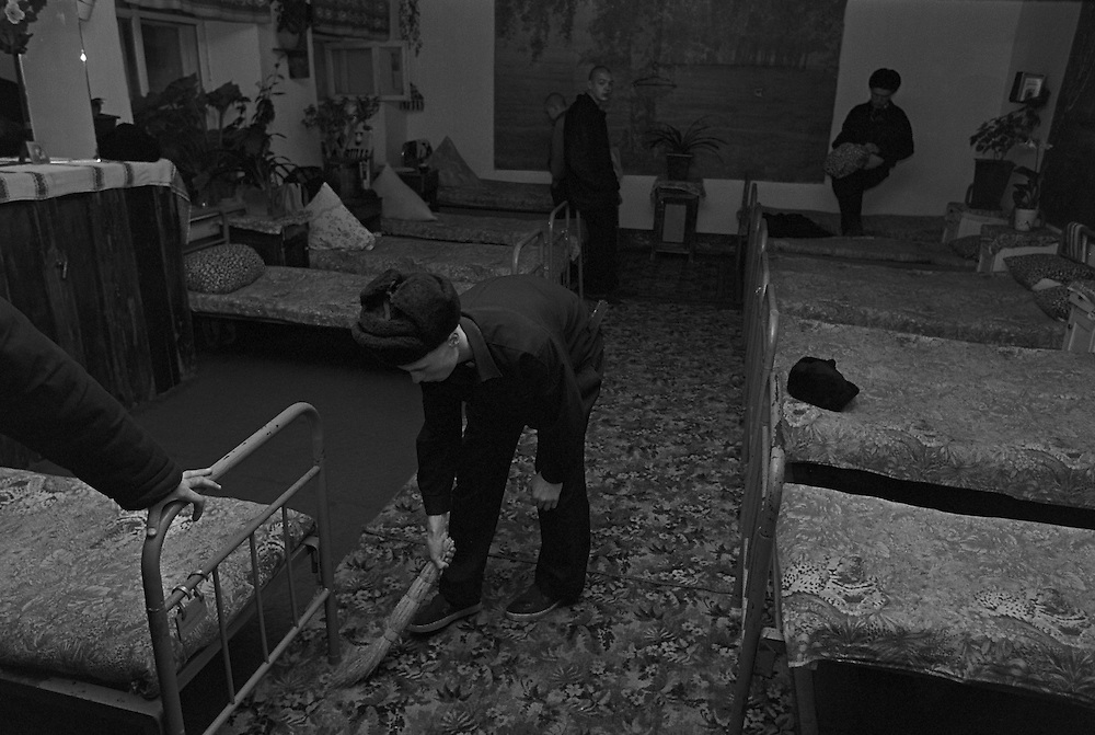 Russian juvenile prisoners prepare clean their living room at the colony for prisoner's children in Siberian town Leninsk-Kuznetsky, Russia, 26 January 2001.