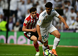 MADRID, April 19, 2018  Real Madrid's Asensio (R) and Ath. Bilbao's Cordoba compete during a Spanish league match between Real Madrid and Athletic Club Bilbao in Madrid, Spain, on April 18, 2018. The match ended 1-1. (Credit Image: © Guo Qiuda/Xinhua via ZUMA Wire)