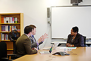 D.C. Public Schools Chancellor Kaya Henderson meets Nathaniel Beers,.chief of the Office of Special Education and Tom Flanagan, left, Interim deputy chief for programming, on Friday, Nov. 16, 2012 in Washington, D.C. Henderson recently announced that she plans to close 20 under-enrolled schools across the district. CREDIT: Lexey Swall for The Wall Street Journal