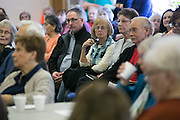 Residents listen as Democrat & Chronicle reporters Sean Lahman and Patti Singer speak at Brighton Senior Program Center on Tuesday, April 5, 2016. Singer and Lahman recently reported on poor conditions at nursing homes in the Rochester area.