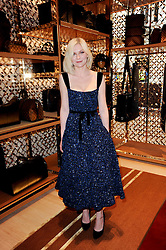 KIRSTEN DUNST at a party to celebrate the opening of the Louis Vuitton Bond Street Maison, New Bond Street, London on 25th May 2010.