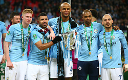 February 25, 2018 - London, England, United Kingdom - L-R Manchester City's Kevin De Bruyne Manchester City's Sergio Aguero Manchester City's Vincent Kompany Manchester City's Fernandinho and Manchester City's David Silva with Trophy.during Carabao Cup Final match between Arsenal against Manchester City at Wembley stadium, London  England on 25 Feb 2018. (Credit Image: © Kieran Galvin/NurPhoto via ZUMA Press)