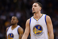 Feb 10, 2016; Phoenix, AZ, USA; Golden State Warriors guard Klay Thompson (11) watches on during the game against the Phoenix Suns at Talking Stick Resort Arena. The Golden State Warriors won 112-104. Mandatory Credit: Jennifer Stewart-USA TODAY Sports