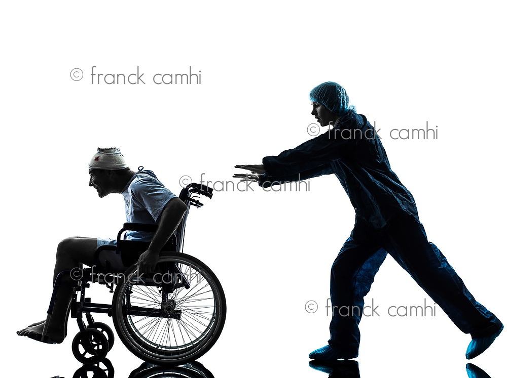 one injured man in wheelchair escaping away of nurse in silhouette studio on white background