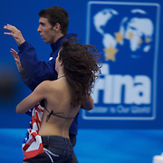 A fan attempts to meet Michael Phelps of the USA as she runs onto the pool deck during presentations at the World Swimming Championships in Rome, Italy on Sunday, August 2, 2009. Photo Tim Clayton.